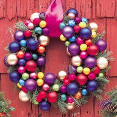 Colourful Christmas Wreath - Good Housekeeping    http://www.goodhousekeeping.com/holidays/christmas-ideas/christmas-door-decorating-ideas#slide-2