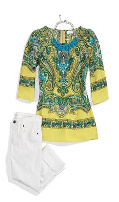 A modern take on retro: This polished paisley-print tunic features three-quarter length sleeves and a zipper back.
