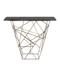 Liev Console. The geometric pattern created by the antique brass rods is in and of itself a piece of art. When we top it with a rough hewn black marble surface, it becomes functional art. Use in a hallway, or as a server in the dining room. Top is not attached.