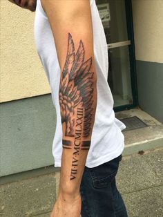 ▷ 1001 + ideas for a beautiful and meaningful angel wings tattoo- angel wings tattoo on back, roman numerals, arm tattoo, man with white top and jeans Forarm Tattoos, Forearm Sleeve Tattoos, Best Sleeve Tattoos, Mom Tattoos, Tattoo Sleeve Designs, Body Art Tattoos, Tribal Tattoos, Men Arm Tattoos, Forearm Wing Tattoo