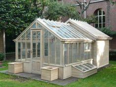 Green house with a chicken coop attached to back