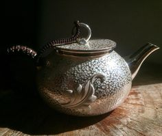 This is a handmade silver teapot. It has a natural beauty as well as flaws. It hasn't been pressed in a mold like some tourist grade teapots you'll see sold online. It was crafted by hand using traditional tools over the course of several days.  Most of these that we have are sold privately and never reach our website. This one is already spoken for. If you are interested in a unique work of art like this please PM or email us.  This teapot is 200ml, weighs 226g, and depending on the…