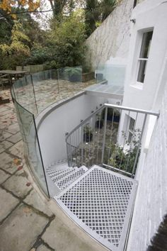 The Belsize Park External Project - This staircase was designed and built to fit and blend with into the rear garden concept, there was no question of making do with what ever happened to be available.