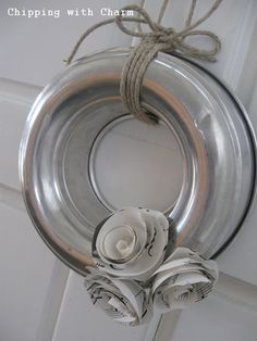 Old baking bundt cake pans as upcycled wreaths! What a fabulous wreath idea! I wonder how large I can find these? It would be great for a year round wreath to use as a finishing touch on the door when it's not Christmas!