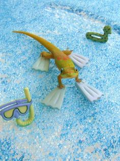 "A rare snorkeler gecko!  ""Gecko Greetings™ cards are the product of years of photographing and studying geckos. The colorful geckos featured in these photos are Gold Dust Day Geckos. The artist photographs geckos for these cards with actual props and such."