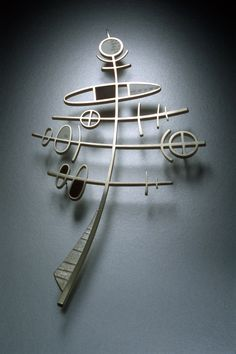 Brooch | Kristin Mitsu Shiga. 'Totem'.  Sterling Silver, Ebony, Piano Key Ivory Scrimshaw, Nickel