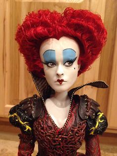 I enhanced this LE Disney Queen of Hearts doll. (Heart on lips bigger, painted line through crack in lips, changed eyes, birthmark, painted thicker lower lashes and painted inside nostril holes.)
