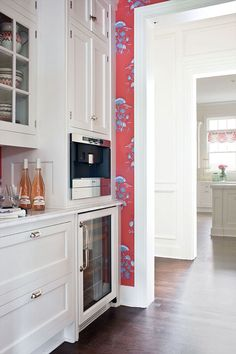 White kitchen with just a snippet of vivid wallpaper to brighten things. So happy! Katie Ridder wallpaper