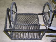 I wonder if we could weld tie downs to something like this  for Nickedys wheelchair..?