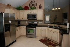Love the cabinets. Can't decide if I want to make mine dark or white?