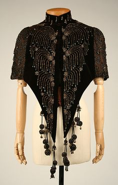 Cape 1885, French, Made of silk.  It's slightly pre-Art Nouveau, but the lines of the beads have an Art Nouveau quality.