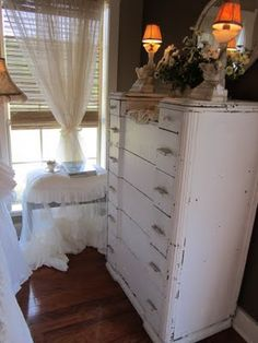 Love the bench with the sheer, ruffles slipcover!