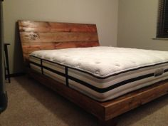 Reclaimed wood bed frame and headboard.