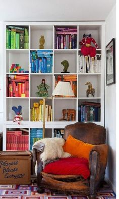 Have more literature than you know what to do with? Organize your books into a chic bookshelf. We love this rainbow arrangement!