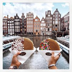 When in Amsterdam, be sure to stop by @vanwonderenfrieten for a delicious #stroopwafel with an amazing view! � • 🌎: Amsterdam, Netherlands / 📸: malia_st_