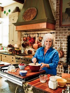 I love the copper pots and brick hearth in Paula Deen's kitchen. Ok, I'll take the whole kitchen Kitchen Redo, New Kitchen, Kitchen Remodel, Kitchen Design, Kitchen Brick, Kitchen Ideas, Brick Hearth, Oven Hood, French Style Homes