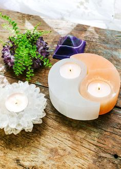 Bring balance into your space with this beautiful yin-yang style candle holder set. Made out of polished white and orange selenite, a stone for serenity, promoting clarity of the mind and expanding on