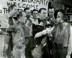 The Sons of the Pioneers in the classic Roy Rogers movies, Utah, with Gabby Hayes. Left to right: Karl Farr, Tim Spencer, Hugh Farr, Ken Carson, Roy Rogers, Bob Nolan and Gabby Hayes.