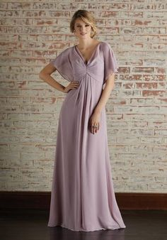 Chiffon Bridesmaid Dress with Capelet Style Sleeves and V-Neckline Chiffon Bridesmaid Dress Featuring a Draped V-Neckline. Caplelet Style Sleeves Add the Perfect Amount of Coverage. View the Chiffon Swatch Card for Color Options. Shown in Desert Rose. Mori Lee Bridesmaid Dresses, Cap Sleeve Bridesmaid Dress, Bridesmaid Dress Colors, Wedding Dresses, Wedding Bridesmaids, Reception Dresses, Bride Dresses, Swatch, Cocktail Dresses Online