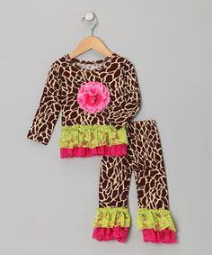 This sweet tunic is bursting with a floral bloom. Even better, cuties will be enamored with the luxurious ruffle trim as well as the quality construction that makes wearing this piece as comfy as can be. With an elastic waistband on the matching leggings, this ensemble is sure tough to beat.