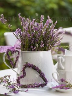 Love this heather centerpiece in the large white metal pitcher