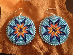 K. Cozad---This lady has to great bead boards!!! Beaded rosette earrings by Heidi Hydrick