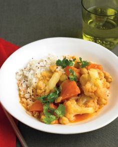 Basic Vegetable Curry | Recipe via Martha Stewart Recipes | Serves 4  Ingredients:  • 1 tablespoon vegetable oil  • 2 teaspoons brown mustard seeds  • 1 medium yellow onion, diced small  • 1 cup long-grain white rice  • coarse salt and ground pepper  • 1...