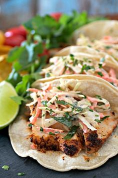 Easy Fish Tacos are a healthy option for a delicious weeknight dinner. Wild haddock fillets are marinated, oven baked, and topped with a spicy cabbage slaw.
