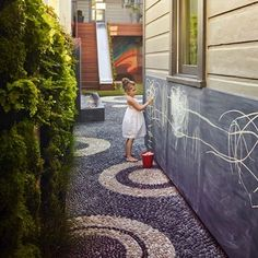 "A traditional Italian ""risseu"" mosaic path by landscape designer Monica Viarengo is the centerpiece for a dynamic, child-friendly yard in SF.  @marionbrenner #GDhardescape"