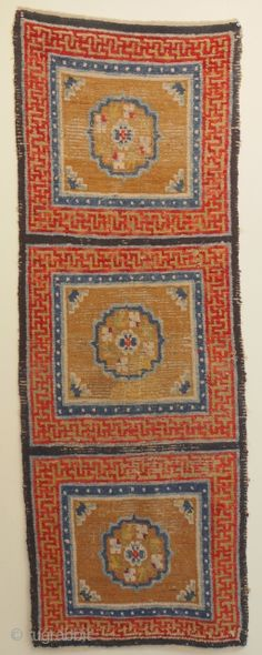 early Tibetan seating rug fragment mid 19C ends rewoven nicely. Great colour some scattered old reweave but a genuine old monastery piece not expensive