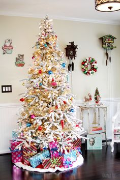 5f0e68851 A Snowy Spruce Flocked Christmas Tree + gold + vintage ornaments