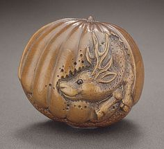 Naito Toyomasa (Japan, 1773 - 1856)  Stag in Chestnut, first half of 19th century  Netsuke, Wood with inlays