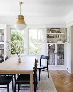 love the edit of this dining space- chic and casual with a statement light fixture room ideas modern room room ideas apartment room ideas on a budget room ideas mid century dining rooms Dining Room Design, Dining Area, Kitchen Dining, Small Dining, Dining Tables, Dining Room Inspiration, Home Decor Inspiration, Living Comedor, Dining Lighting