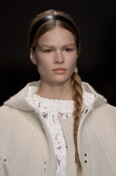 Braids are still in but a more minimalist finish. Styled by Guido for Valentino