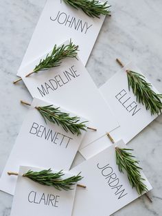 simple rosemary place setting cards [use thick cardstock and punch small holes at both sides of the top of the card, then remove the needles from each end of the rosemary before inserting into the card holes]