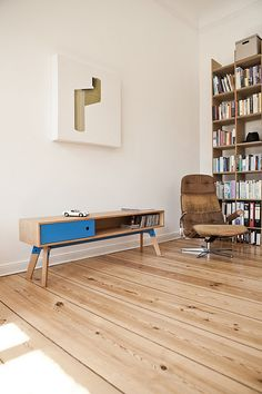 Sideboard table, wooden floors, retro furniture piece.