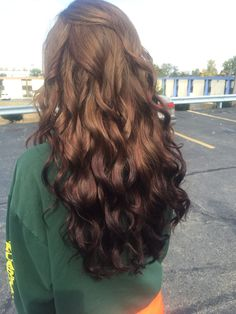 Cosmetology students work. Natural light brown fading to a red brown ombré