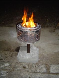 I would love to have this washing machine drum fire pit on my deck! #repurpose #recycle