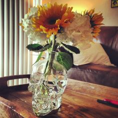 Recycling a Crystal Head Vodka bottle--just add flowers! I'm doing this with mine!