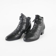 Channel your inner witchy woman with these wicked vintage ankle boots. Made of soft black leather, with a decorative leather lace up detail on the front with tassel tie! They have inner zippers for easy on and off, and pointy toes. The low heel makes then great for all day wear. Pair with a red lip and black cat for casting spells and breaking hearts.  Brand: Spectra. Made in Brazil. Era: 1990s Size: 8 (fits small, too tight for my size 8) Estimated fit: 7 Materials: Leather upper, man made…