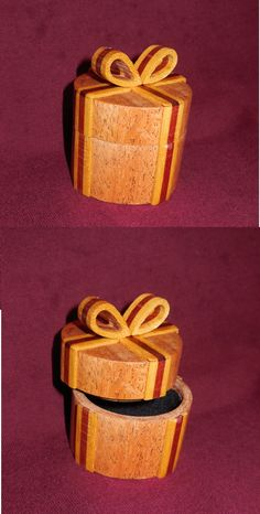 Ring presentaion box for special occasions: Mohogany with yellow heart and bloodwood ribbon.