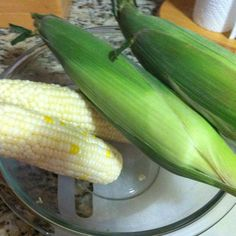 Best way to cool corn on the cob!!! Microwave corn, uncleaned/unshucked, microwave for 4-5 minutes per ear, remove from microwave and cut off stock end (make sure you cut off at least one row of kernels), grab the top end of the ear and squeeze/shake and the corn will just slip out! No hair, mess or pain of shucking corn! AMAZING :)