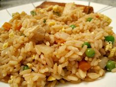 Chicken fried rice served with homemade vegetarian egg rolls!