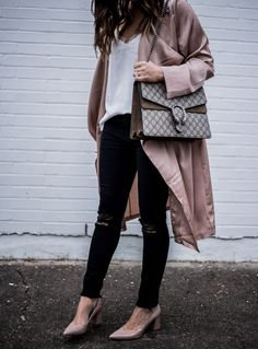 Lifestyle blogger Tiffany Jais of Flaunt and Center wearing a Satin blush duster paired with black distressed skinny jeans   what's currently trending in women's fashion 2016