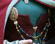 Inspiration - Viking women often wore strands of beads suspended from the brooches on their apron dresses.