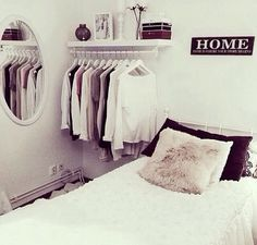 Cute open closet idea for guest bedroom. That way the actual closet can be used as extra storage.