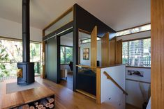 Contemporary dedicated TV room with wooden windows [Design: Matt Elkan Architect] Architecture Awards, Residential Architecture, Small Living, Living Area, Living Room, Living Spaces, Modern Tropical House, Wooden Windows, Modern Fireplace