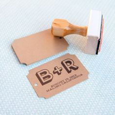 Personalized Wedding Favor Tags and Stamp - 100 Wedding Favor Tags and Personalized Monogram Stamp. $44.95, via Etsy.