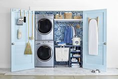 22 Reasons Why Blue Is the Best Color for Decorating Your Home: Sky blue doors and the blue print wallpaper add a feeling of cleanliness to one place it definitely belongs: the laundry room.