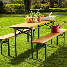 Biergarten table! Pretty please put this on clearance. (Also, whoever styled this has the wrong idea about what belongs on these tables...)